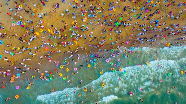 HAIKOU, CHINA: Aerial view of a crowded at beach in Haikou, Hainan Province of China during the Dragon Boat Festival. Photo: Getty