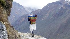 Elise Wortley with her chairpack in Sikkim. PA Photo/Handout.