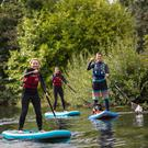 Firsttimers try Stand Up Paddle Boarding, with Soulkite, at Killaloe, County Clare. Photo: Patrick Bolger/Fáilte Ireland