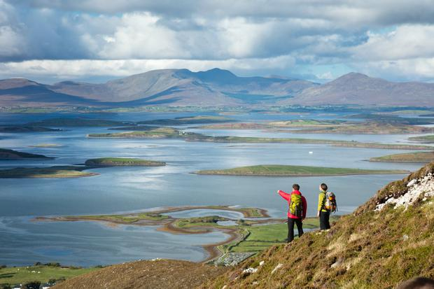 Walkers on the slopes of Croagh Patrick, above Clew Bay, Co Mayo. Photo: Gareth McCormack/Fáilte Ireland