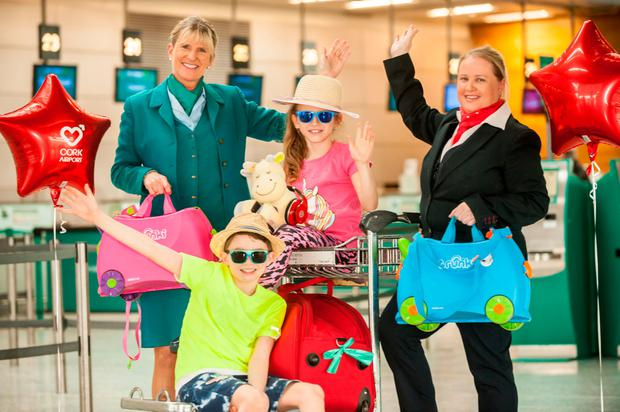 Brother and sister Calum and Alex Carroll from Carrigaline all ready for their summer holidays as Cork Airport launched its 2018 summer schedule. Pic: Brian Lougheed