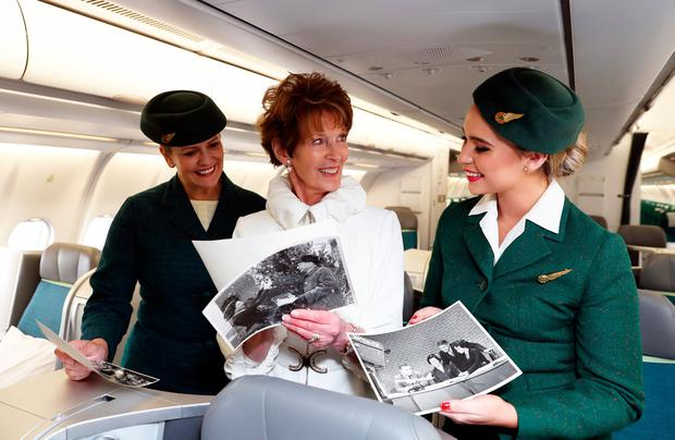 Aer Lingus cabin crew Muriel Cooke and Mae Mc Greevy with former air hostess Lily O'Connell (79) from Leopardstown who worked on Aer Lingus early flights crossing the Atlantic some 60 years ago. Picture: Jason Clarke.