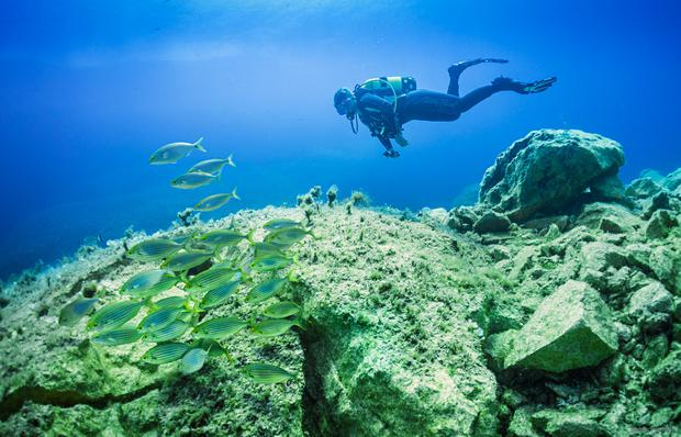 Diver at the Azure Alps. Photo: Visit alta