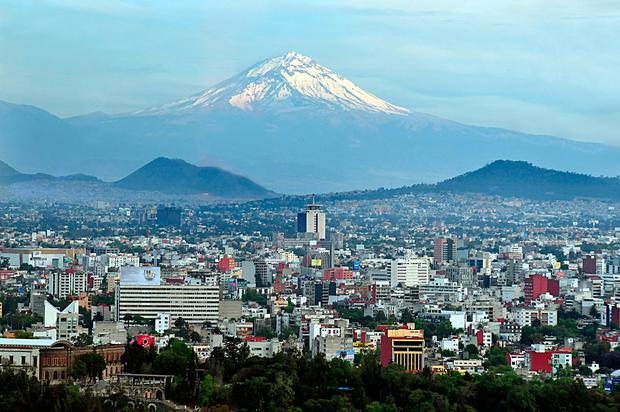 Aerial landscape view of the Popocatepetl volcano mountain rais above Mexico city