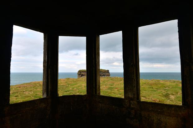 View from inside a Coastal Watch Station ('LOP') by Downpatrick Head, Co. Mayo. Photo: Pól Ó Cnghaile