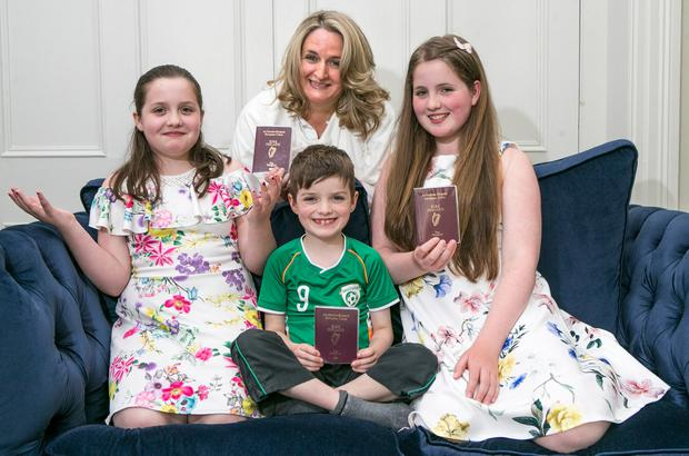 Cliona Fanning with her children Katie (9),Jamie (7) and Maggie (12). Katie was waiting two months for her passport. Photo: Kyran O'Brien
