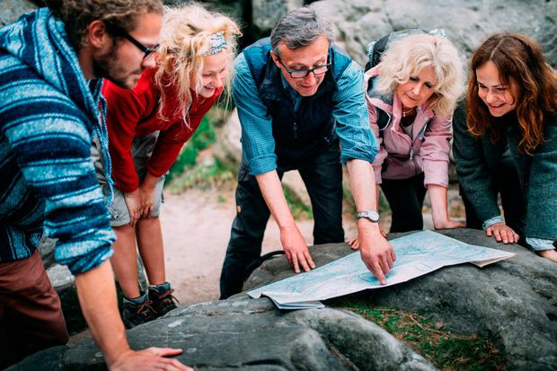 Hikers planning a route. Photo: PA Photo/thinkstockphotos.
