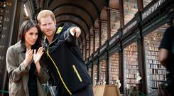 Composite image of Prince Harry and Meghan Markle (Photo: Getty) with Trinity College's Old Library in the background (Photo: Fáilte Ireland).