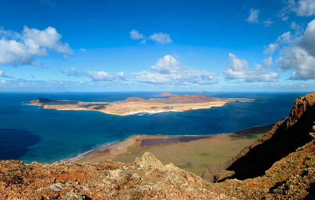 The reef around Mirador del Rio offers a beautiful view above the east coast of the island and Graciosa Island. Photo: Getty