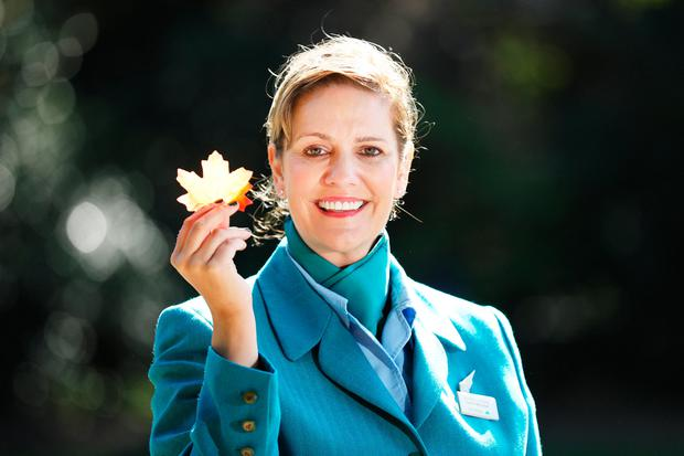 Pictured at the launch of new routes in Dublin's Iveagh Gardens was Aer Lingus cabin crew Muriel Cooke. JULIEN BEHAL PHOTOGRAPHY.