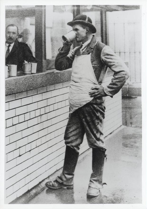 A Guinness drayman 'at tap' - or collecting his daily beer allowance - around 1910. Photo: Guinness Archives