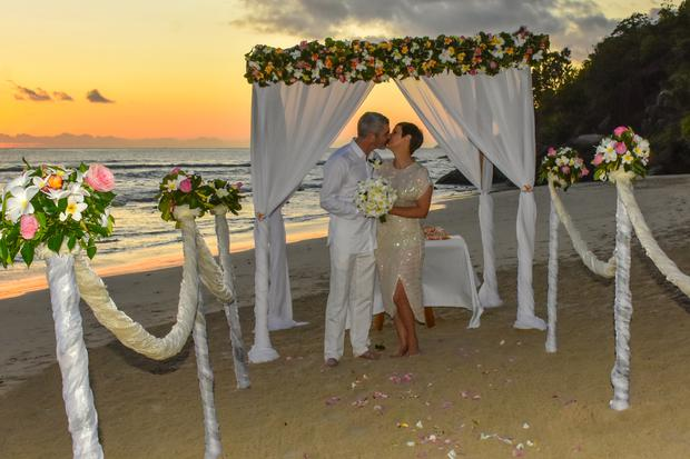 Gemma and John on Anse Louis Beach following their sunset wedding organised by Maia Luxury Resort and Spa, on Mahe, the largest of the Seychelles islands