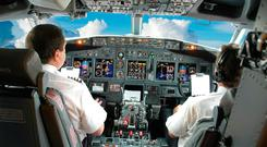 Pilots in the cockpit during a commercial flight. Photo: Deposit