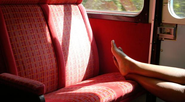 Feet on a train seat. PA Photo/Thinkstock.
