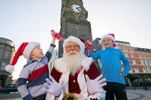 Pictured with Santa in Waterford City were brothers Isaac (9) and Evan (6) Sullivan. Winterval features over 60 free and ticketed events across Waterford city. Picture: Patrick Browne