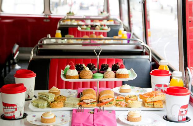 Afternoon tea on a double-decker bus. PA Photo/MakeMyDay.