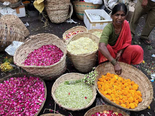 A lady selling flowers at the Dadar Flower Market in Mumbai. PA Photo/Harriet Line.