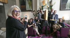 Darina Allen taking a photo of the IFWG Awards winners in the hotel foyer. Photographer - Paul Sherwood