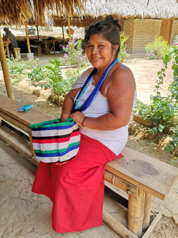A Wiwa woman makes handicrafts in Gotsezhi village