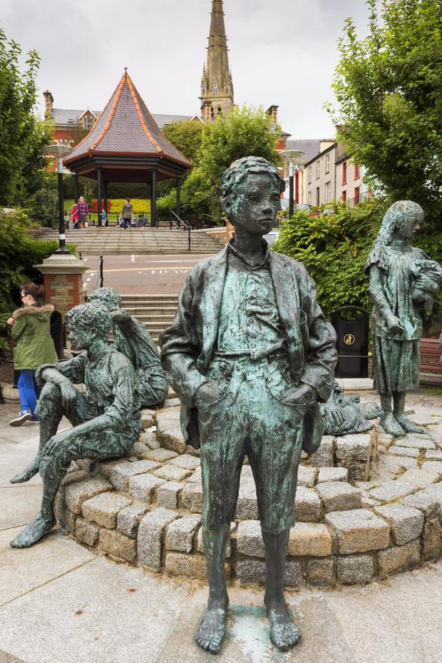Statue of Boy at Letterkenny Market Square.jpg