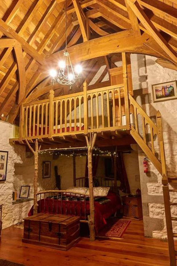 The main bedroom with its 'tree bed' and mezzanine