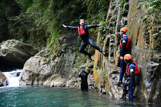 Damon Smith jumps from the cliffside during an afternoon of river tracing in Hualien in Taiwan. PA Photo/Love Wilds Co Ltd/Damon Smith.