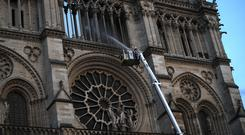 Notre Dame Cathedral appears in several films and novels (Francois Mori/AP)