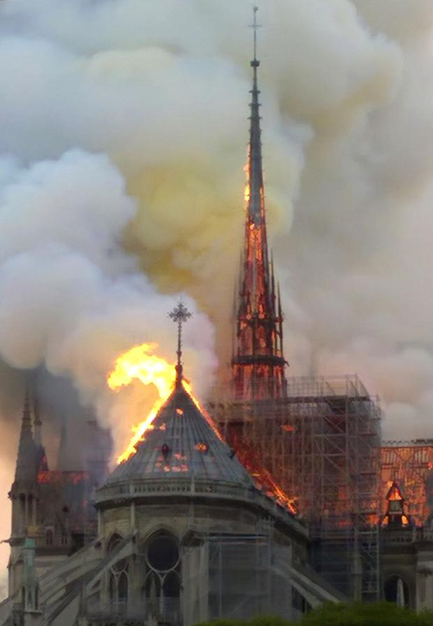 The spire and parts of Notre Dame cathedral on fire (AP Photo/Dominique Bichon)