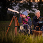Aoibhlinn Steger (9) and her 11 year-old sister, Ailbhe, try the stargazing with Mary White of Blackstairs Eco Trails in Co Carlow. Photo: Dylan Vaughan