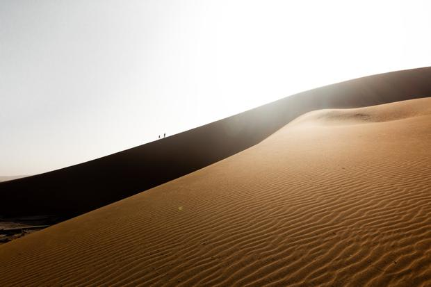 Tourists climbing the dunes in the Namib Sand Sea.jpg