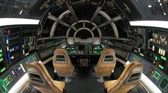 The cockpit of the Millennium Falcon: Smugglers Run attraction at Star Wars: Galaxy's Edge at Disneyland, California. PA Photo/Joshua Sudock/Disney Enterprises/Lucasfilm.