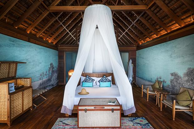 An overwater bungalow bedroom at Bawah Reserve. Photo: Bawah Reserve/PA.