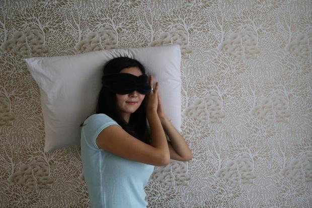 Jane Chung with her pillow and eye-mask. PA Photo/Calm.