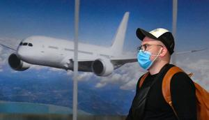 A tourist travels through an airport this January. Photo by SERGEI SUPINSKY/AFP via Getty Images