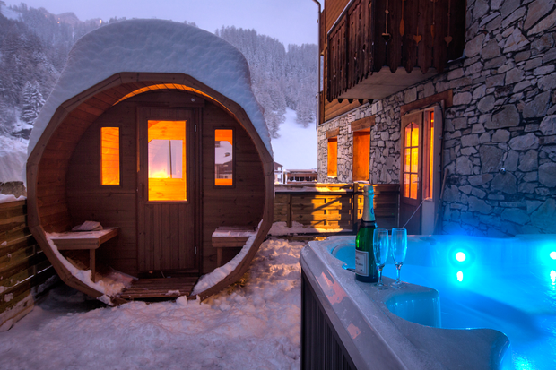 A view of the sauna and hot tub as Chalet Alisier