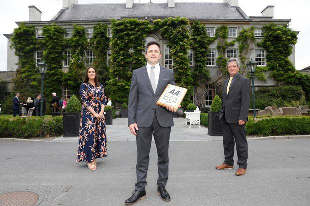 Mount Juliet Estate is named AA 'Hotel of the Year'. Pictured are (l to r) Arwen Foley, AA Ireland; Mark Dunne, General Manager of Mount Juliet Estate; and Conor Faughnan, Director of Consumer Affairs AA Ireland. Photograph: Leon Farrell / Photocall Ireland