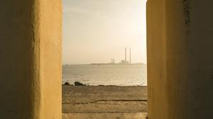 Looking through an archway at Dollymount Beach, towards the Pigeon House stacks. Photo: Rob Dursten / Fáilte Ireland