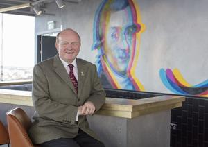 Paul Carty, Managing Director, Guinness Storehouse, sits by a new mural by Aches at the new Gravity Bar in the Guinness Storehouse in Dublin. Picture: Arthur Carron.