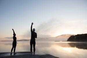 An early morning stretch before a swim at Ballcuggaran, near Killaloe, County Clare on the Lough Derg Blueway. Photo: Patrick Bolger/Fáilte Ireland