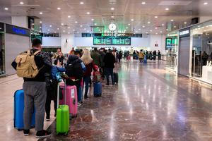 Travelers queue at a departures terminal in Barcelona on March 14, 2020. Photo by Adria Salido Zarco/NurPhoto via Getty Images