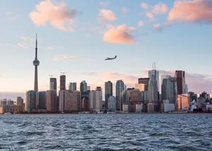 A small turbo prop aircraft plane flies over Toronto  as it comes in to land at Billy Bishop Airport. Photo: Deposit