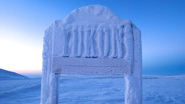A snow-covered Yukon sign on the Dempster Highway. PA Photo/Holger Bergold.