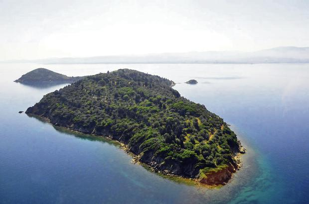 Silver Island comprises 60 acres of olive groves and cypress trees rising out of the sea