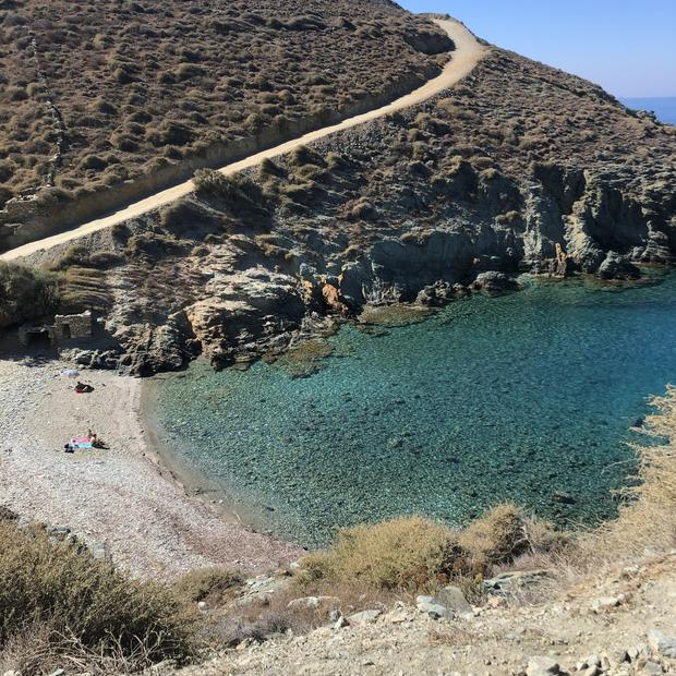Eleven months after the author's wedding day, the couple spent two weeks hiking, swimming and relaxing on a trio of remote Greek islands. Here, a small beach on the island of Folegandros. CREDIT: Photo by Elizabeth Kiefer for The Washington Post.