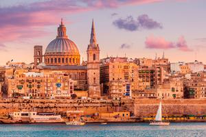 Valletta skyline at sunset with the Carmelite Church dome and St. Pauls Anglican Cathedral