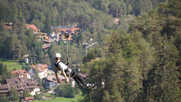 Ziplining high above San Vigilio in the Dolomites