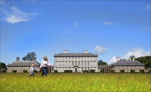 Eilish and Isobel Conachy stroll across the meadows in front of the beautiful and imposing Castletown House, Ireland's biggest Palladian house