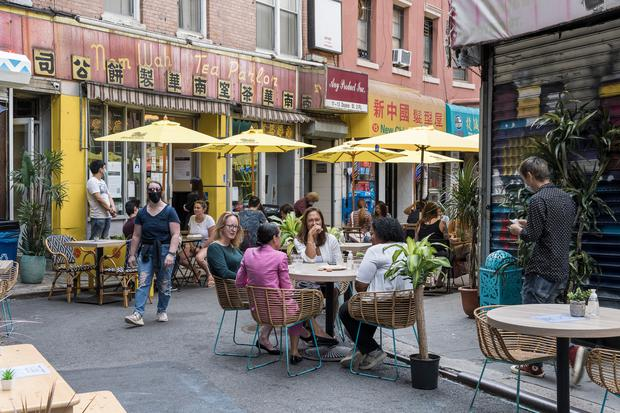 Patrons sit at temporary outdoor seating in China Town, Manhattan. Photo for The Washington Post by Phillip Reed.