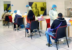 Passengers being tested before boarding an Emirates flight this week.