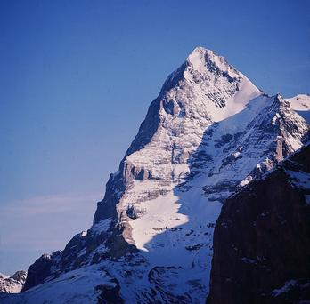 The magnificent Eiger, with its jagged teeth-like ridges, towers over all it surveys.